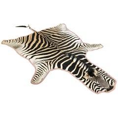 Forsyth Zebra Hide Rug Trimmed in Blush Pink Velvet