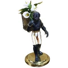 Italian Polychromed Blackamoor with a Bundle of Venetian Glass Flowers