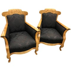 Pair of 19th Century Oversized Carved Biedermeier Bergere Chairs