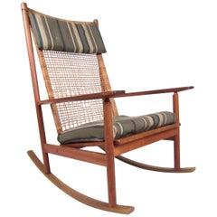 Scandinavian Modern Teak and Cane Rocking Chair by Hans Olsen