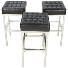Trio of Tuffed Chrome and Leather Stools after Ludwig Mies van der Rohe