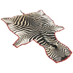 Zebra Hide Rug Trimmed in Maasai Warrior Blanket