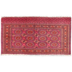 Antique Turkoman Tekke Rug with Repeating Medallion Design in Fuchsia
