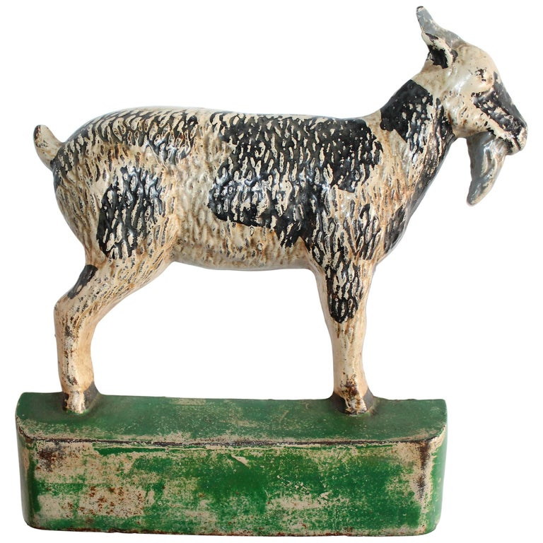 Cast Iron Goat in Original Painted Surface For Sale
