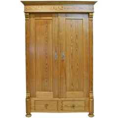 19th Century European Two-Door Pine Armoire with Drawers and Retractable Doors