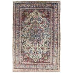 Ornately Detailed Antique Persian Lavar Kerman Rug with Floral Design