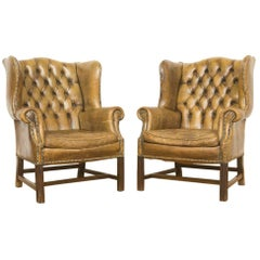 Pair of Two Cognac Leather Wingback Chesterfield Club Chairs, circa 1950