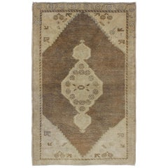 Midcentury Turkish Oushak Rug with Medallion and Cornices in Brown and Taupe
