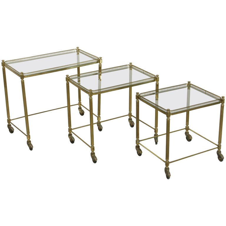 Set of Three Midcentury French Brass and Glass Nesting Tables on Casters