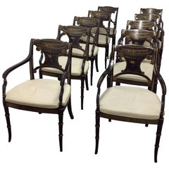 Set of Ten Regency Style Parcel-Gilt Black Painted Caned Armchairs
