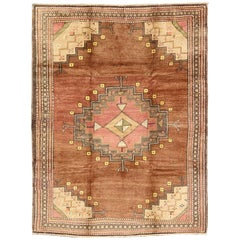 Tribal Medallion Vintage Turkish Oushak Rug in Shades of Brown and Red