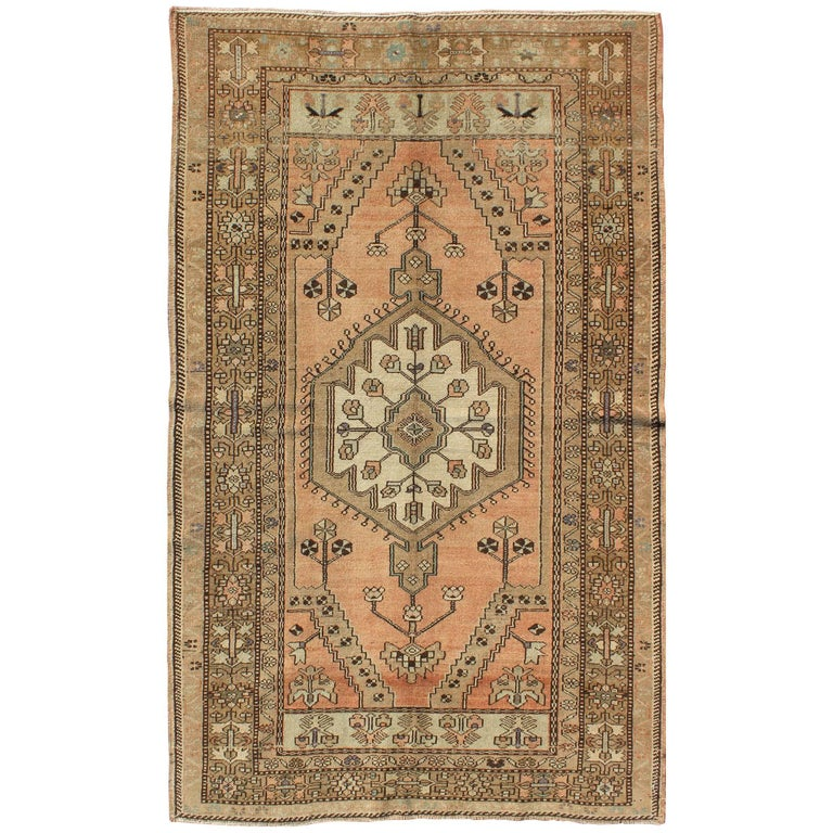peach colored floral vintage turkish oushak rug with multiple ornate