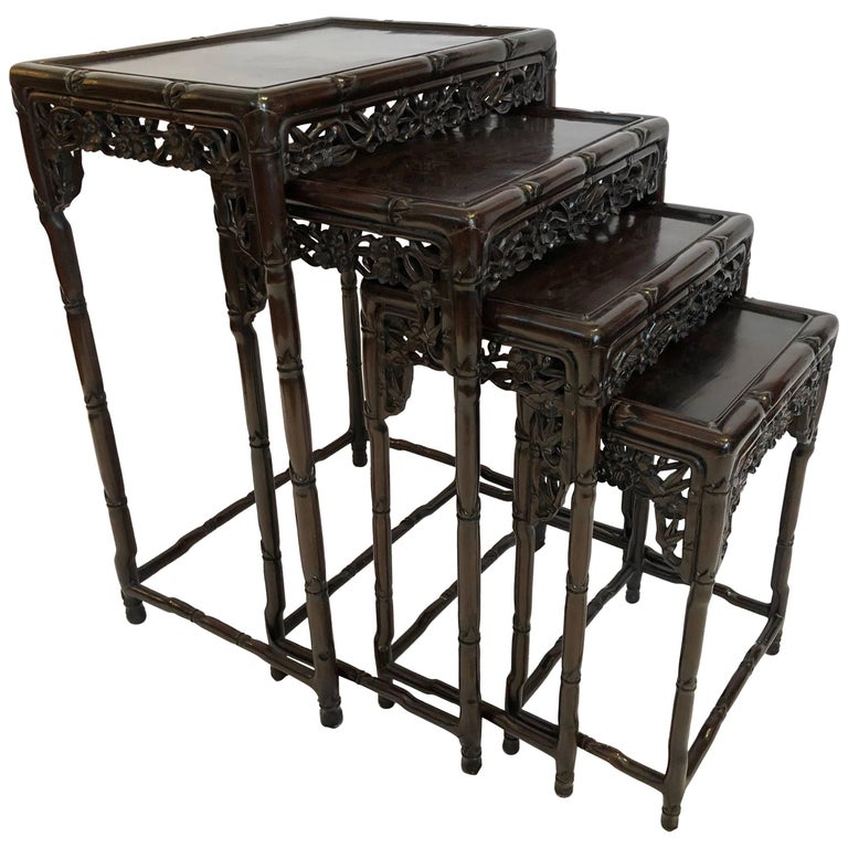 Four chinese rosewood nesting tables circa 1920 floral for Oriental furniture hong kong