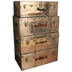 Stack of Four Polished Aluminum Steamer Trunks
