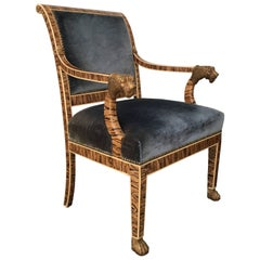 French Empire Style Upholstered Faux Bois Armchair with Gilded Lion Accents
