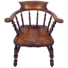 Mid-19th Century English Elm and Fruitwood 'Smokers Bow' Elbow Chair