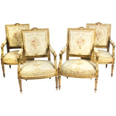 Antique Set of Four Louis XVI Revival Giltwood Armchairs Late 19 Century