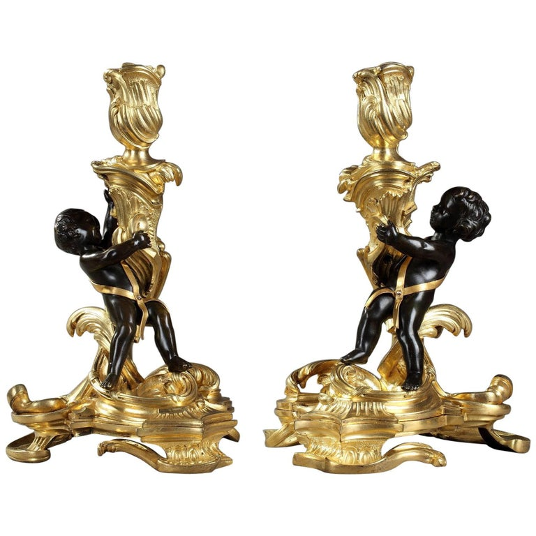 Pair of Gilt and Patinated Bronze Candlesticks after a Model by Meissonnier