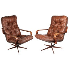 1970s Pair of Leather Swivel Armchairs