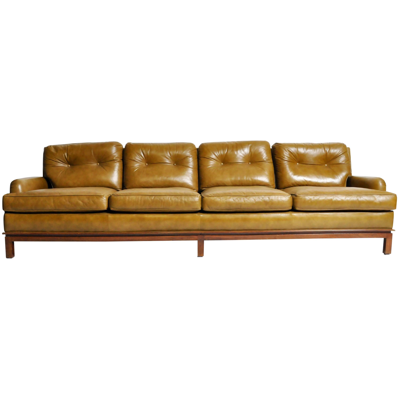 midcentury modern green leather sofa with hardwood base by edward wormley