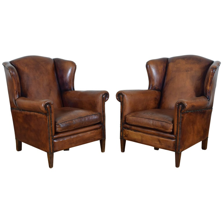 Pair of English Cognac Colored Leather Wing Chairs from the Mid-20th Century
