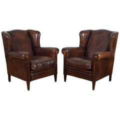 Pair of English Leather Upholstered Wingchairs with Piping, circa 1940s