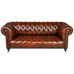 English Georgian Style Distressed Oxblood Leather Chesterfield Sofa, circa 1960