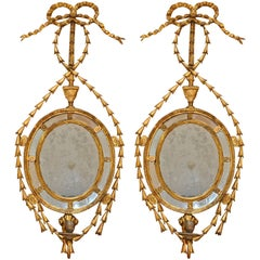Pair of Period Gilt Adam Mirrored Sconces with Ram's Head Motif and Candle Arm