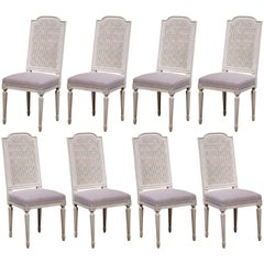 19th Century French Set of Eight Louis XVI Painted Dining Chairs with Cane Back