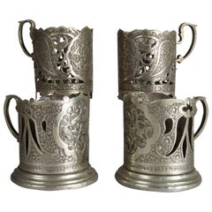 Four Russian Repousse and Reticulated .800 Silver Cup Holders, 19th Century