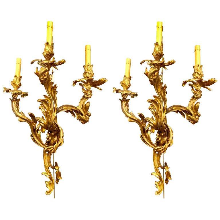 Pair of Louis XVI Style Bronze Three Light Gilt Bronze Sconces