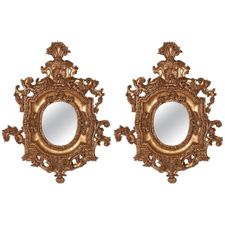 Pair of Ornate Oval Mirrors Hand-Carved Wood Finished in Aged Gold Leaf