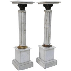 Early 20th Century Pair of Marble Pedestals with Bronze Details