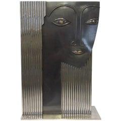 Modern Styled Chrome Face Vase Sculpture