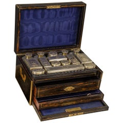 Asprey, an Early Victorian Silver Gilt Mounted Cut Glass Dresser Set in a Fitted