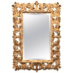 Heavily Carved French Frame Flanking a Bevelled Glass Wall or Console Mirror
