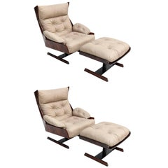 Pair of Novo Rumo, 1960s Brazilian Jacaranda Lounge Chairs and Ottomans