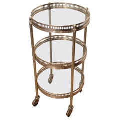 Small Round Brass Three-Tiered Table on Casters by Maison Jansen