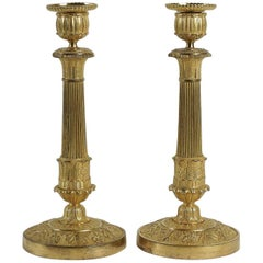 French Empire Period, Pair of Chiseled Ormolu Candlesticks, circa 1810