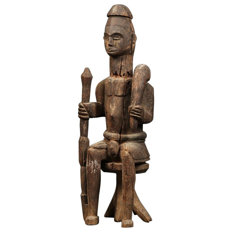 Large Tribal Seated Igbo Ikenga Figure with Sword, Early 20th Century, Nigeria