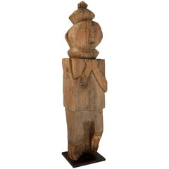 Wooden Tribal Statue from West Nepal, Mid-20th Century, Mounted on a Metal Plate