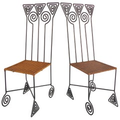 Sculptural Pair of High Back Wrought iron Chairs with Woven Seats