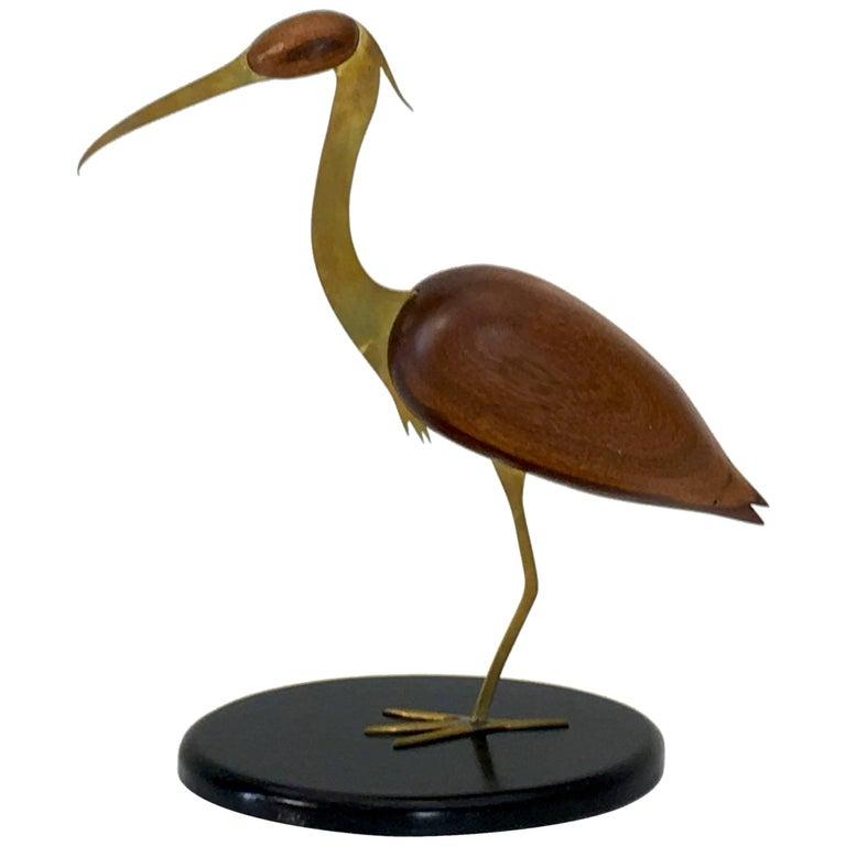Crane brass and walnut table top sculpture by Bill Scott