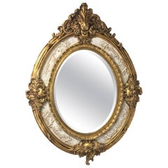 19th French Empire Period Gilt Wood Oval Mirror with Carved Marble