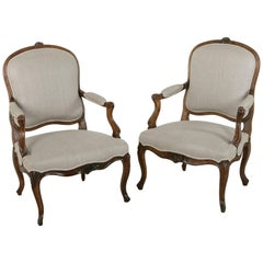 Pair of 19th Century Hand Carved Walnut French Louis XV Style Armchairs in Linen