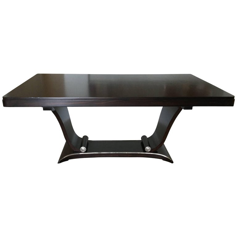 Sophisticated and sleek italian rosewood dining table for for Sleek dining room tables