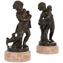 Pair of Antique Bronze Figures of Cherubs and Animals