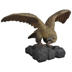 Carved Eagle with Outstretched Wings Perched on Rocks