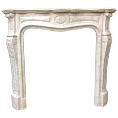 Antique French Victorian Louis XVI Style Carved Marble Fireplace Surround.