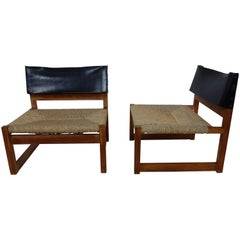 Pair of Leather and Rush Seated Lounge Chairs by Javier Carvajal